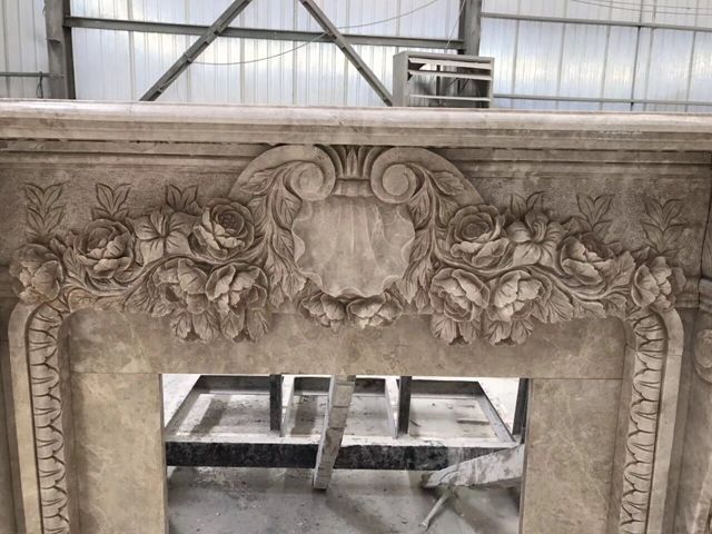 Carved Rose Marble Fireplace