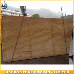 Dramatic Golden Macauba Granite Slab