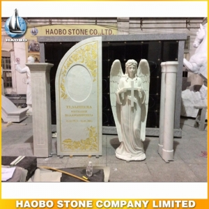 White Marble Angel Headstone With Carved Cross
